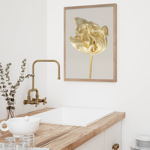 bathroom counter with framed art print on the wall