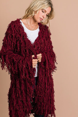 KNITTED OPEN FRONT CARDIGAN WITH A FEATHER-LOOK FRINGE