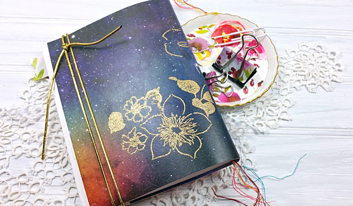 Notebook covered with Altenew Watercolor Nebula washi tape