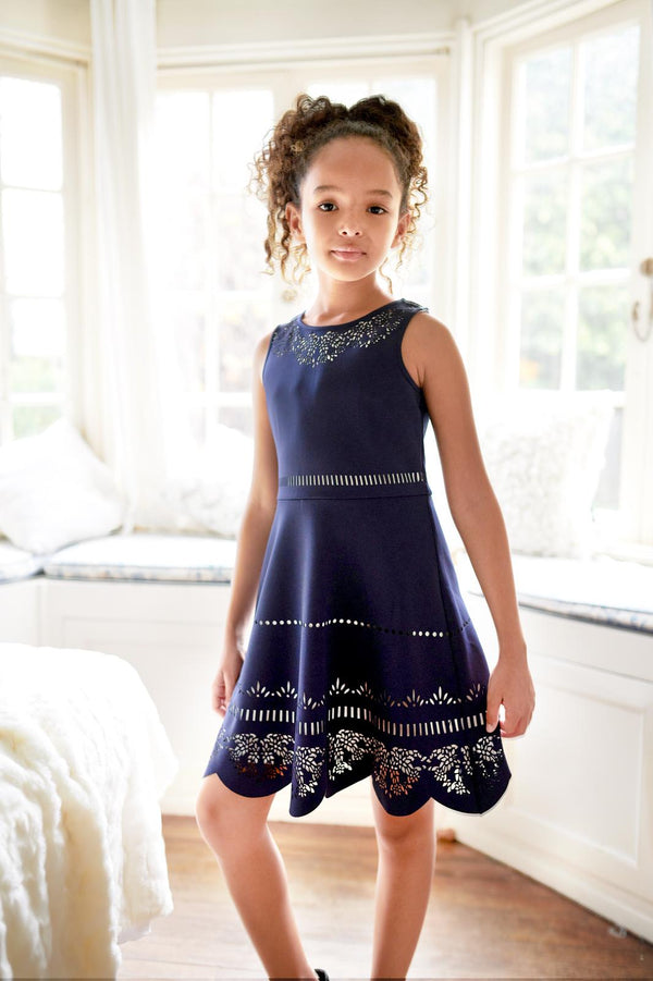 NAVY LASER CUT DRESS WITH CONTRAST LINING.
