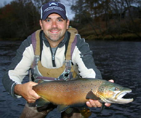 Mike K. with a huge Little Red River brown trout!