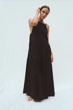 Model wearing the Austen tiered maxi dress in black - UNIK by us - front view