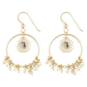 The Riviera Earrings - 14k gold-filled, dangle earrings with a shell charm and freshwater pearls, by Elvis et moi.