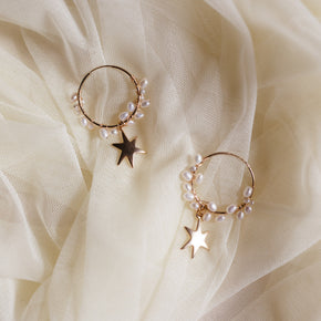 The Mateo Earrings - 14k gold-filled, hoop earrings with a string of freshwater pearls and a star charm, by Elvis et moi.