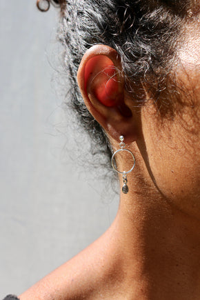 Model wearing the Brillant Earrings - sterling silver stud drop earrings with a zirconium charm by Elvis et moi