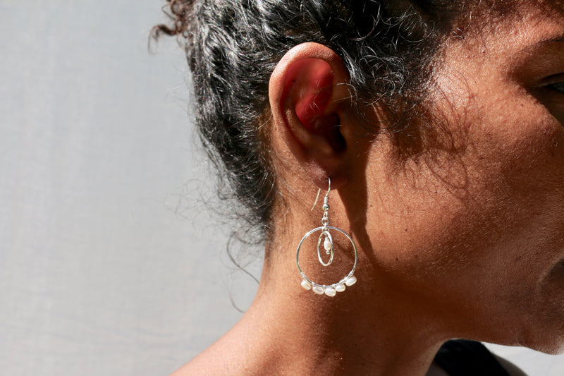 Model wearing the George Earrings - sterling silver dangle earrings with a string of freshwater pearls by Elvis et moi