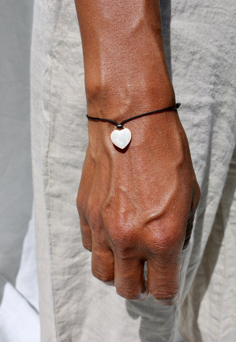 Model wearing the Art Bracelet - cord tie bracelet with gold-filled heart charm, by Elvis et moi