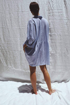 Model wearing the Byron oversized linen shirt in blue pinstripe - UNIK by us