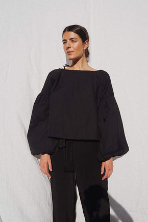 Model wearing the Charlotte billowed sleeve blouse in black - UNIK by us