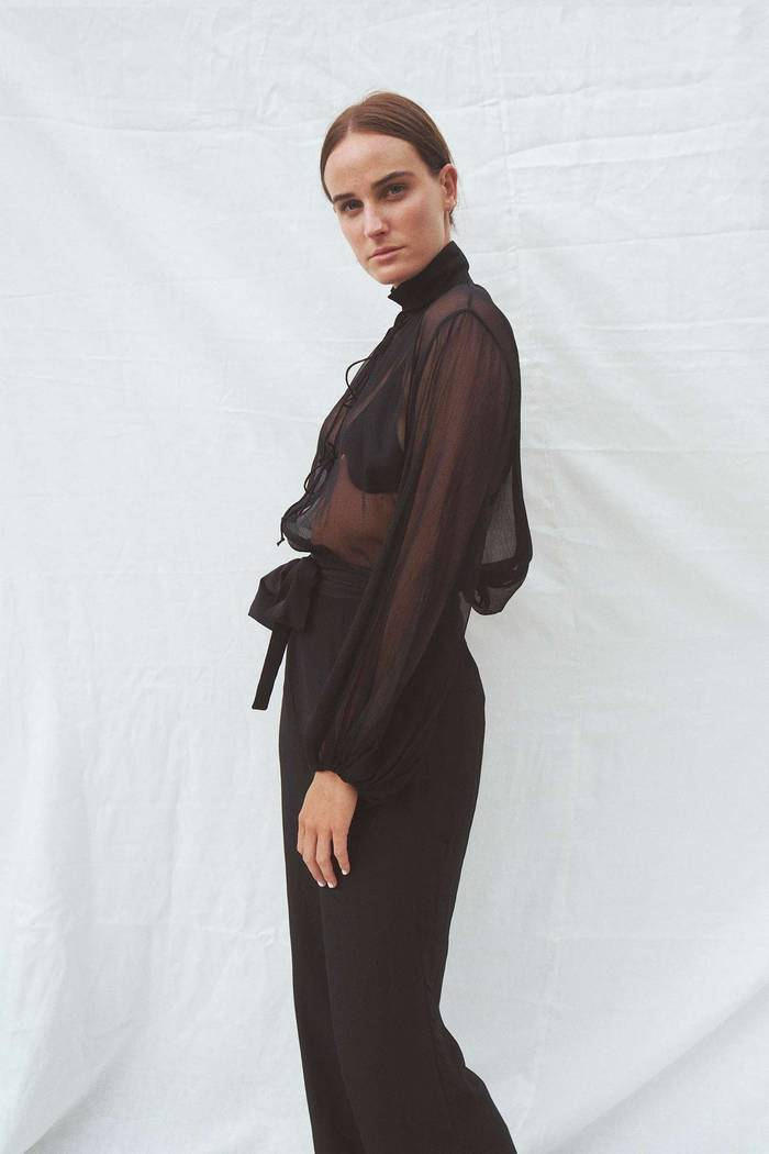 Model wearing the Taylor silk blouse in black - UNIK by us