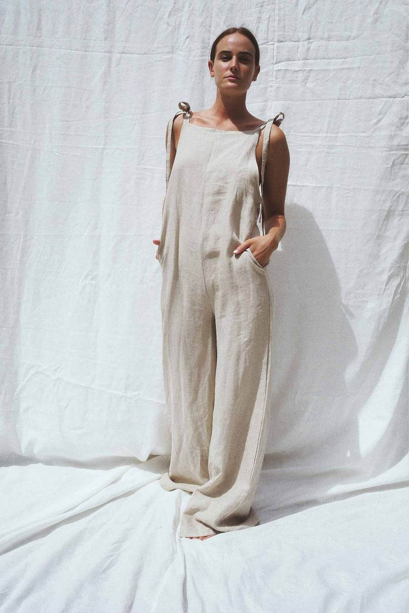 Model wearing the Wilde linen jumpsuit in sand - UNIK by us