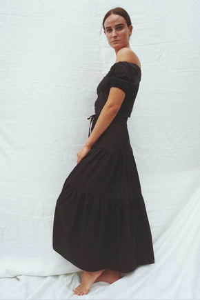 Model wearing the Isabella off the shoulder dress in black - UNIK by us