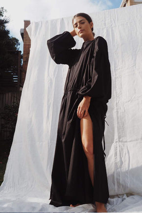 Model wearing the Kaspara billowed sleeve dress in black - UNIK by us