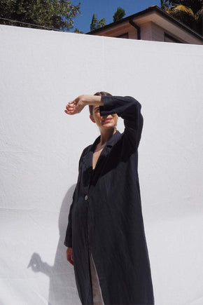 Model wearing Victor oversized linen coat in indigo - UNIK by us