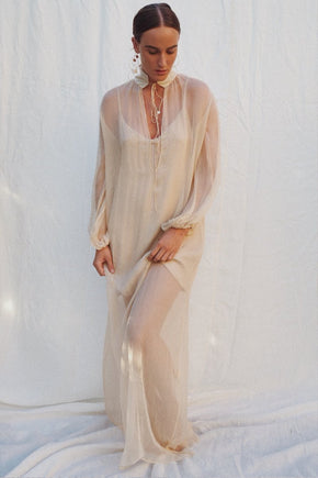 Model wearing the Cullen silk chiffon maxi dress in champagne - UNIK by us