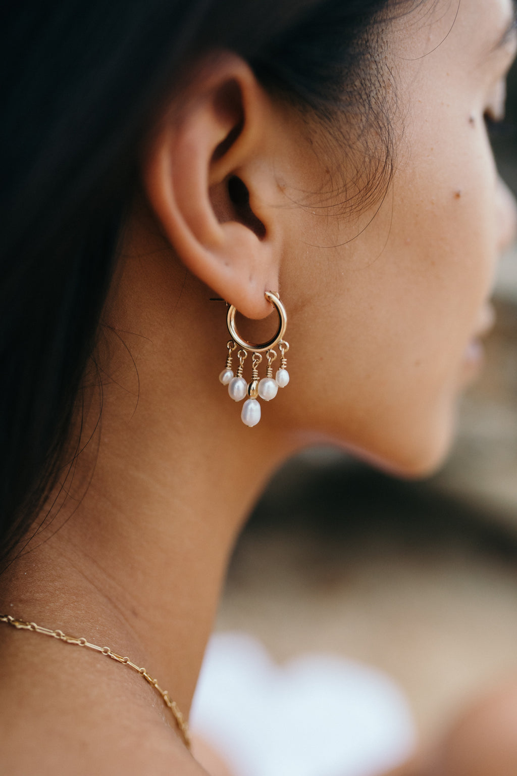 Model wearing the Tara Earrings - 14k gold-filled mini hoops with freshwater pearls, by Elvis et moi