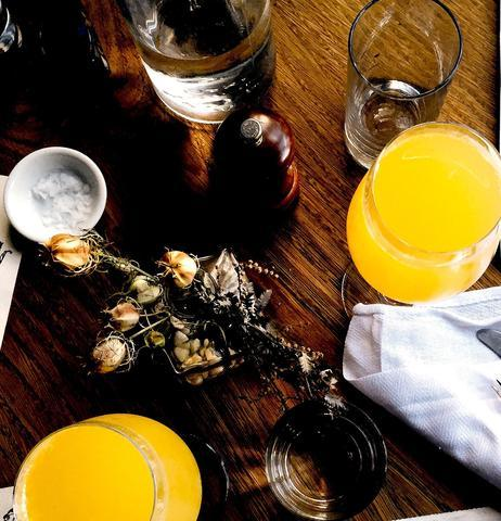 image of brunch mimosas at wooden dining table