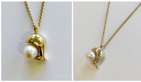 Necklace with dolphin pendant and pearl