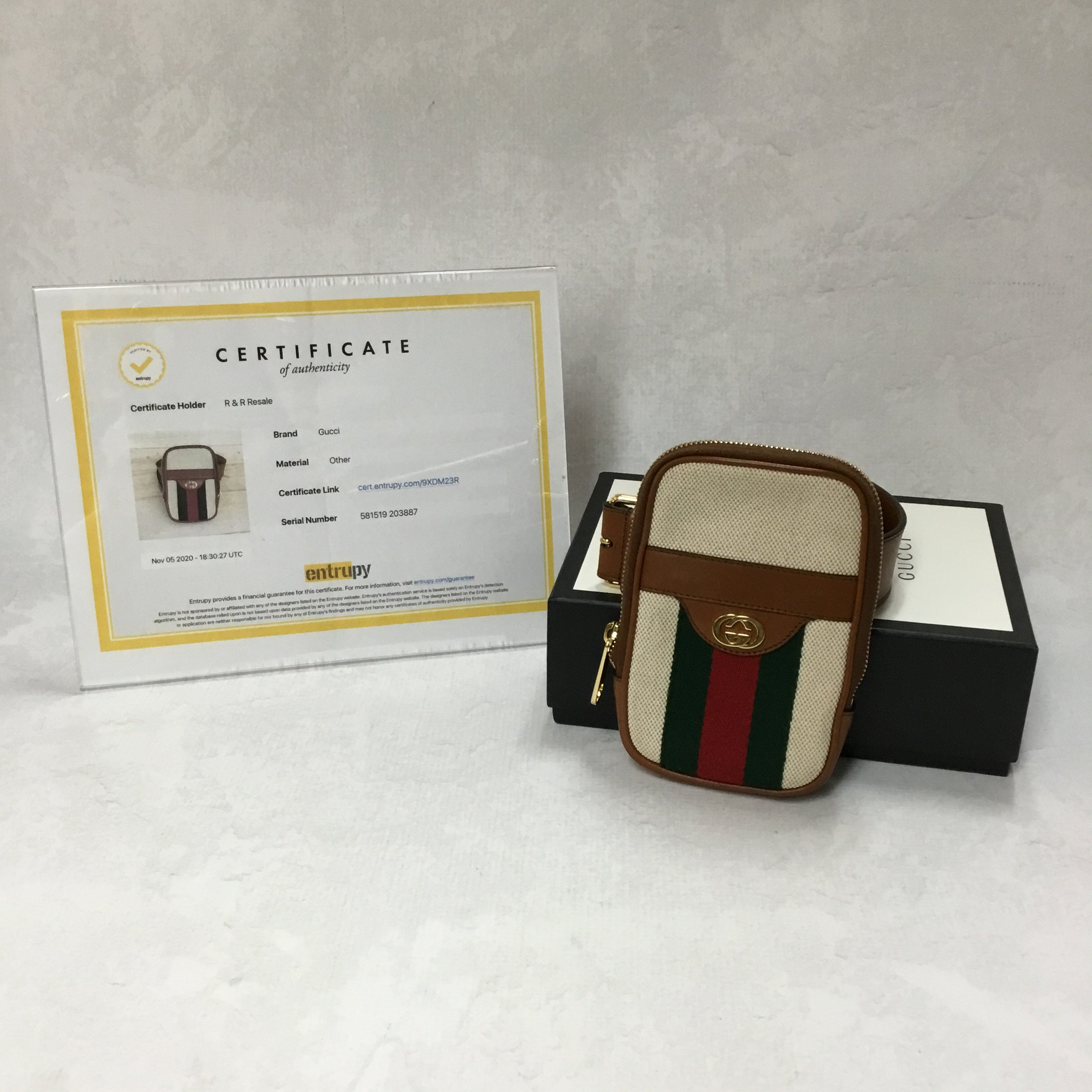 Primary Photo - BRAND: GUCCI <BR>STYLE: HANDBAG DESIGNER <BR>COLOR: IVORY <BR>SIZE: SMALL <BR>OTHER INFO: CANVAS BELTED IPHONE CASE <BR>SKU: 194-19414-36992<BR>70*28<BR>COMES WITH BOX AND DUST BAG