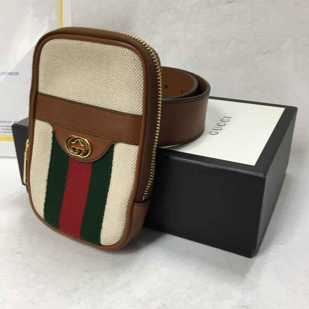 Photo #1 - BRAND: GUCCI <BR>STYLE: HANDBAG DESIGNER <BR>COLOR: IVORY <BR>SIZE: SMALL <BR>OTHER INFO: CANVAS BELTED IPHONE CASE <BR>SKU: 194-19414-36992<BR>70*28<BR>COMES WITH BOX AND DUST BAG