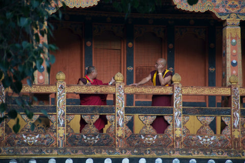 monks talking outside of a Bhutan monastary