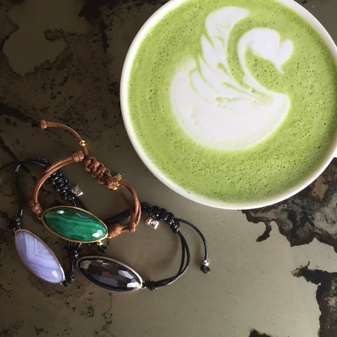 Lattice Corded Friendship Bracelets in Natural stones on marble table next to Matcha Latte