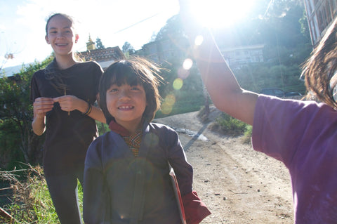 Claire and young Bhutanese children playing