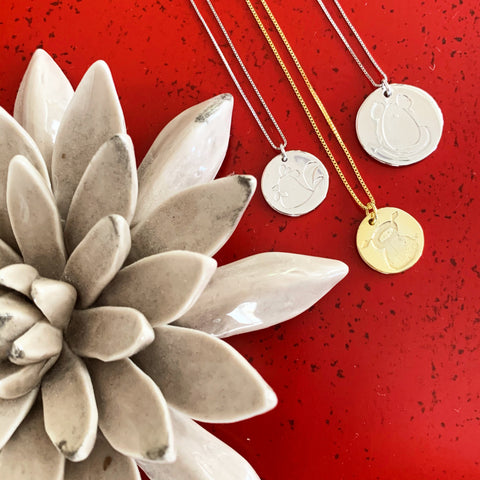 Chinese New Year Necklaces on red table with ceramic succulent