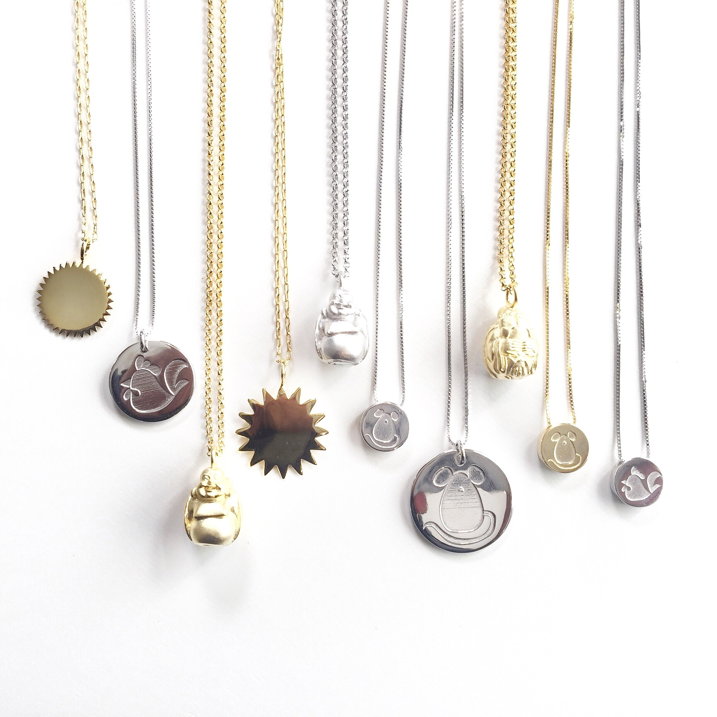 Sunburst, Buddha, Chinese New Year Necklaces hanging together