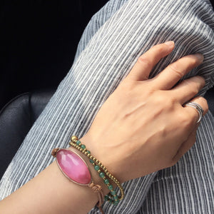 pink dignity Bracelet - Dress For Success Vancouver | Values Bracelet on striped pants