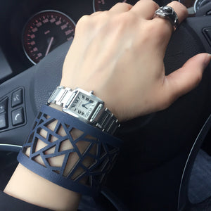 Driver wearing Margaret Laser Cut Bracelet paired with watch