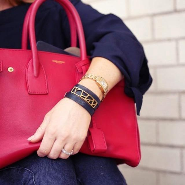 Blogger Hilary Kennedy holding red carry all wearing Lattice Triple Wrap Leather Bracelet