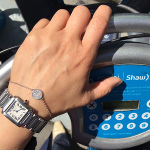 woman holding shaw bike sharing service wearing Little Jewels Disk Bracelet With Crystals