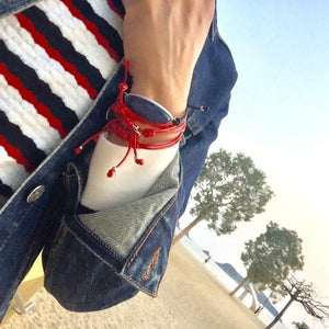 women at beach with denim jacket wears the Bracelet - String Of Destiny With Red Carnelian