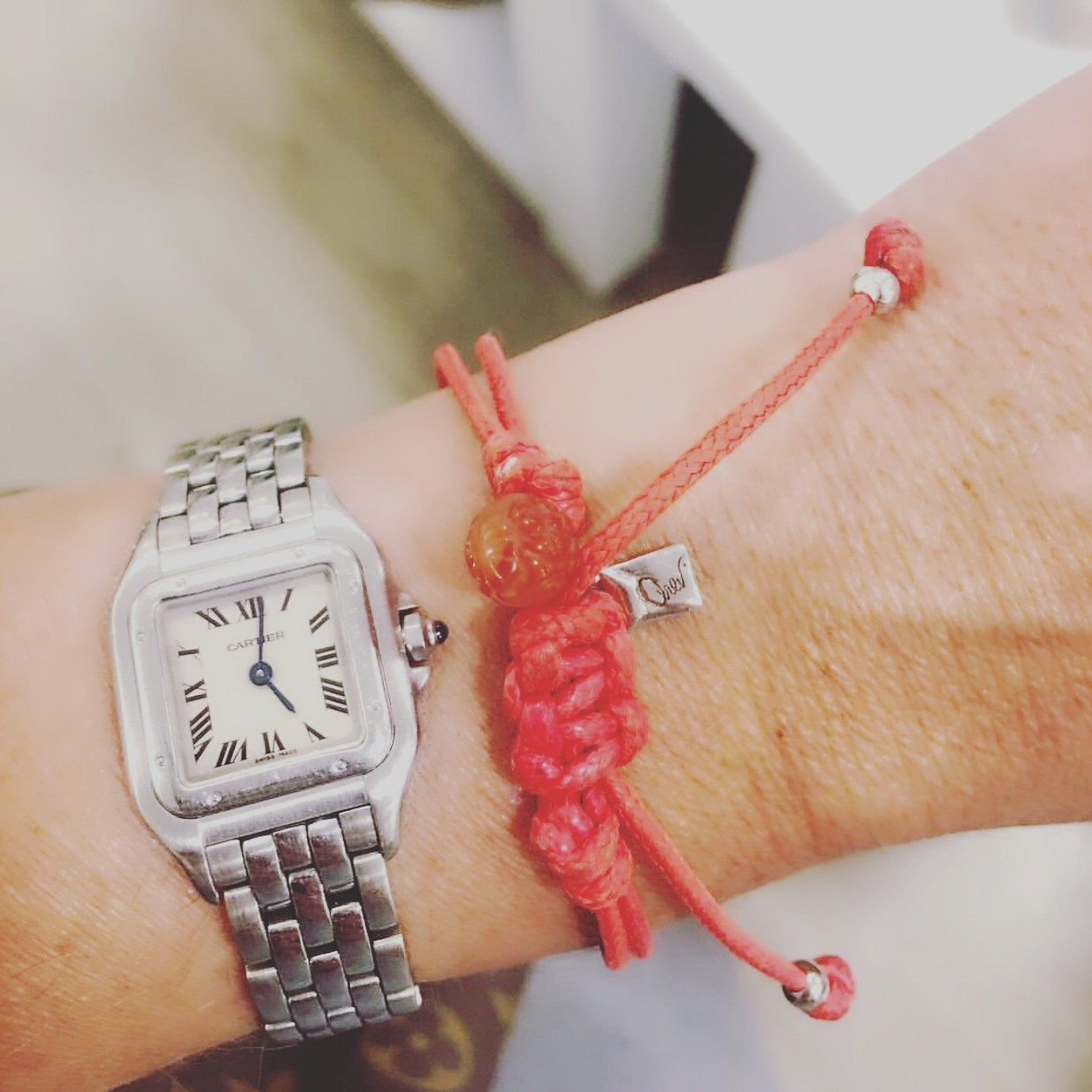 woman's wrist wearing a watch and Bracelet - String Of Destiny With Red Carnelian