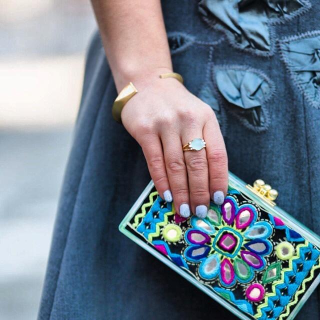 blogger Shira Rose holding clutch wearing Mantra Dagger Cuff With Swarovski Crystals