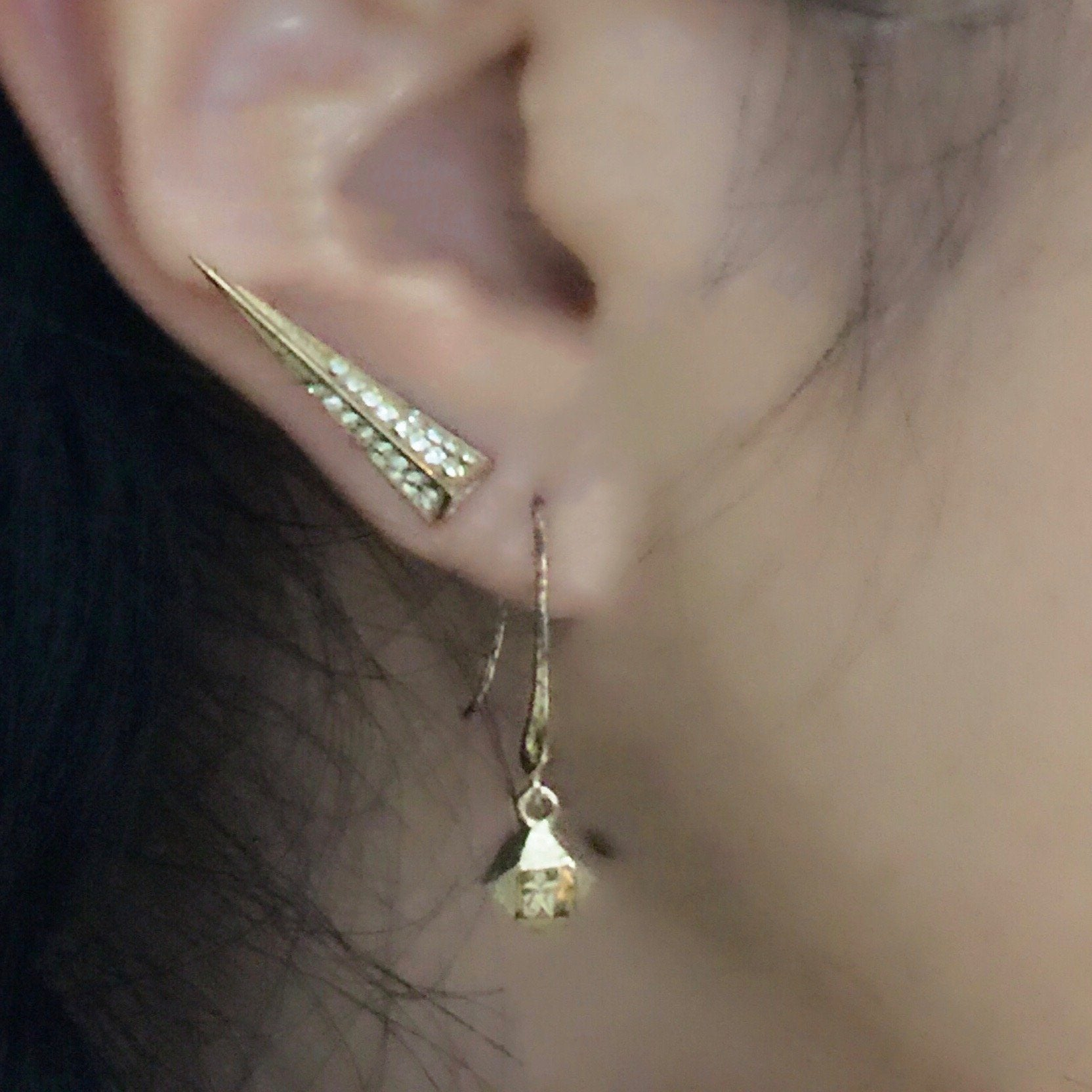 Woman wearing Mantra Dagger Earrings and Mantra Cube Earrings - Engraved