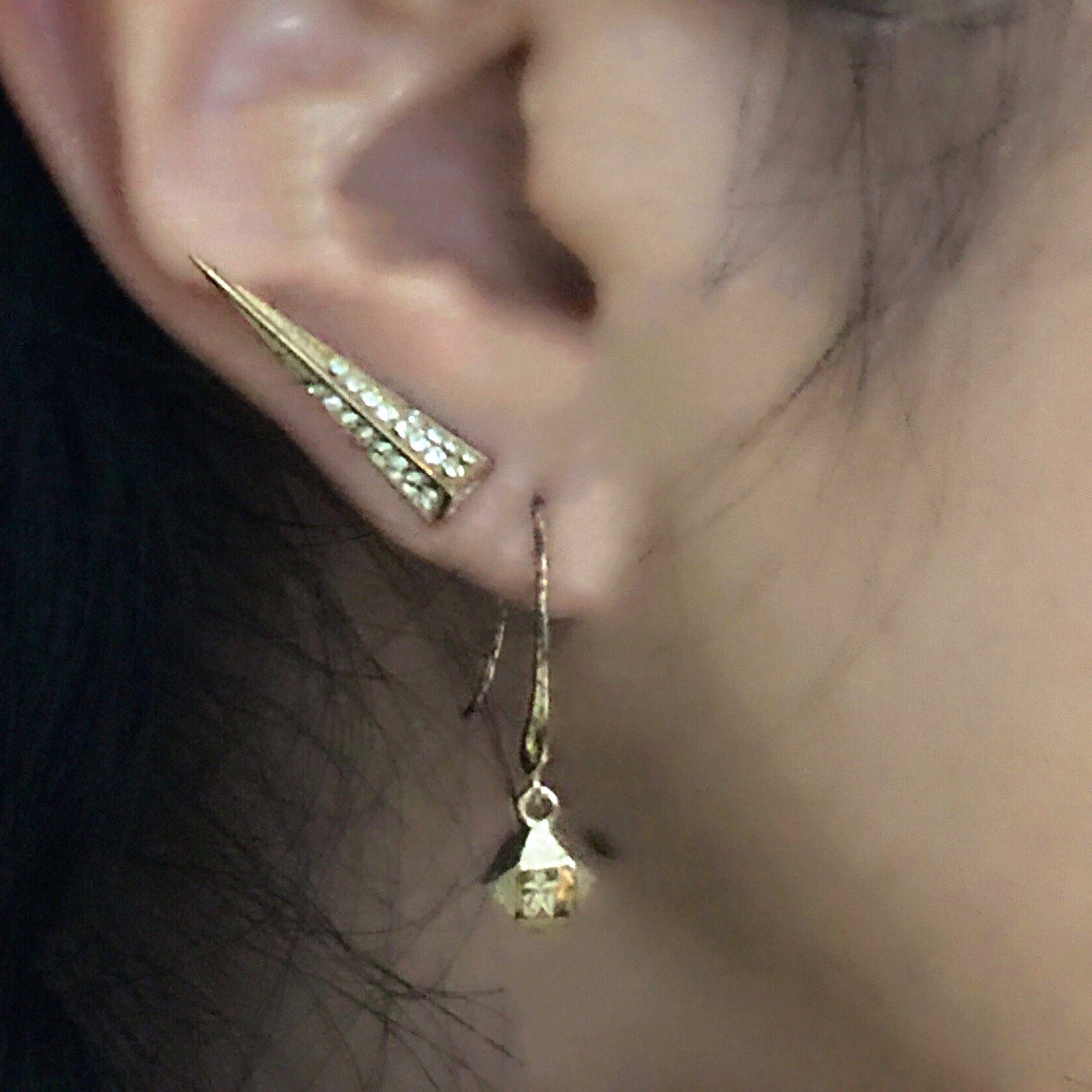 Close up of Mantra Dagger with Swarovski Crystal earrings and Mantra Cube Earrings