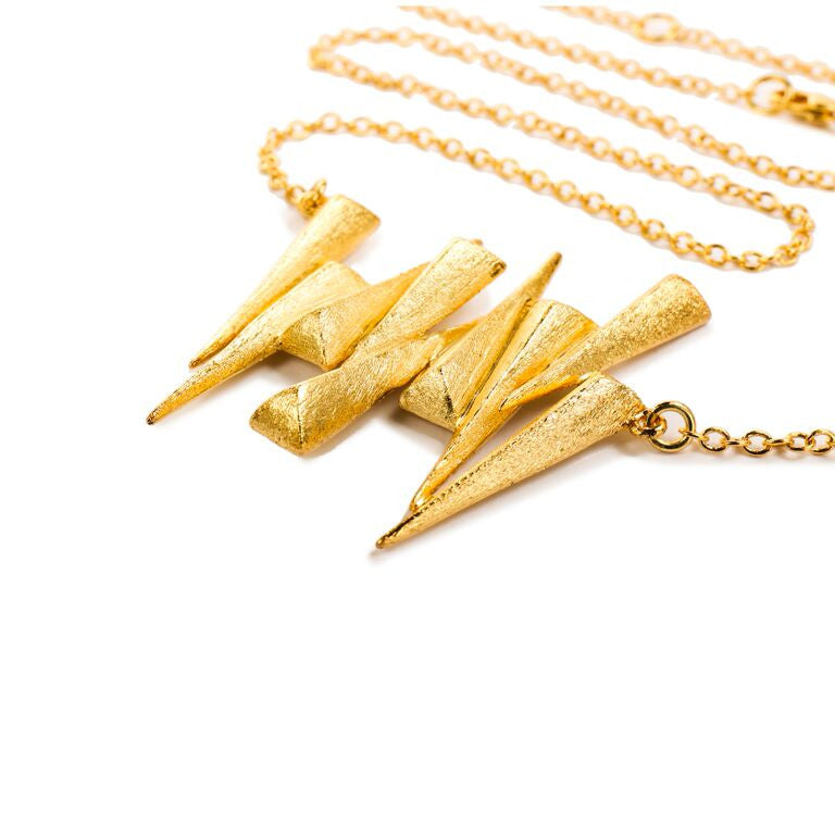 Mantra Nine Daggers Necklace and gold