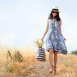 Blogger Jane Song of FitFabFun Mom in blue sun dress with straw hat wearing Mantra Six Dagger Necklace - rhodium