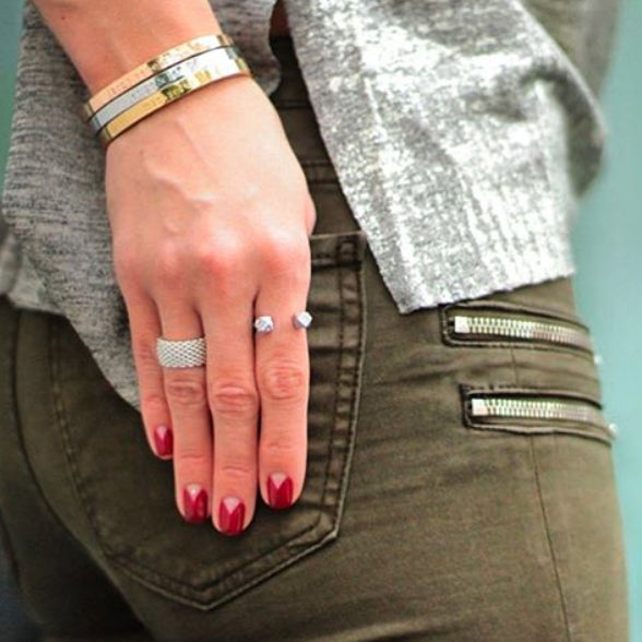 woman in grey and camouflage pants with hands on the side wearing Mantra Open Cube Ring with Swarovski Crystals