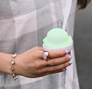 woman wearing Lattice Cocktail Ring - rose quartz while holding mint shaved ice