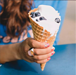 woman wearing the rose quartz Ring - Lattice Cocktail Ring holding frozen yogurt with blueberries