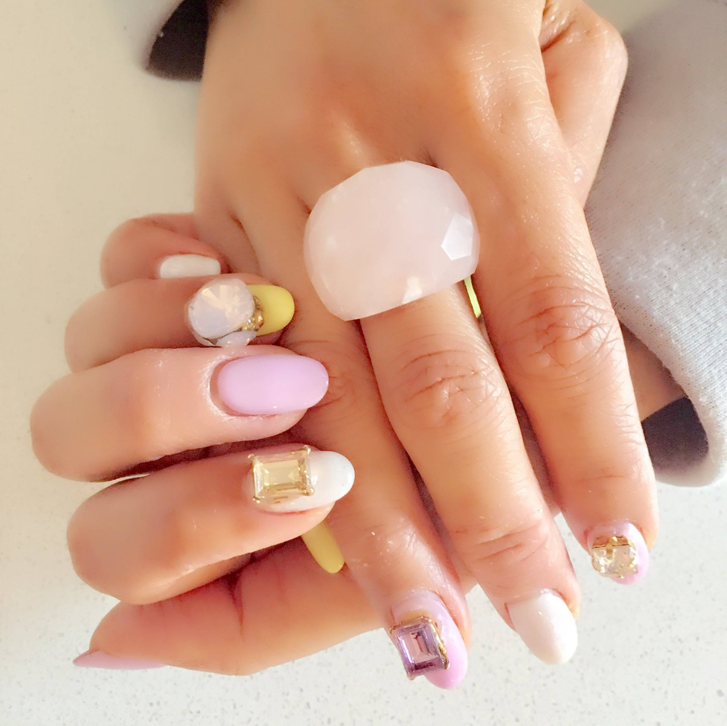 woman with pink mani with stones and Lattice Round Cocktail Ring With Natural Stones
