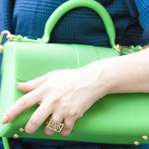 Blogger Veronica of Bittersweet Colours Ring wearing blue dress holding green bag with Lattice Square Cocktail Ring