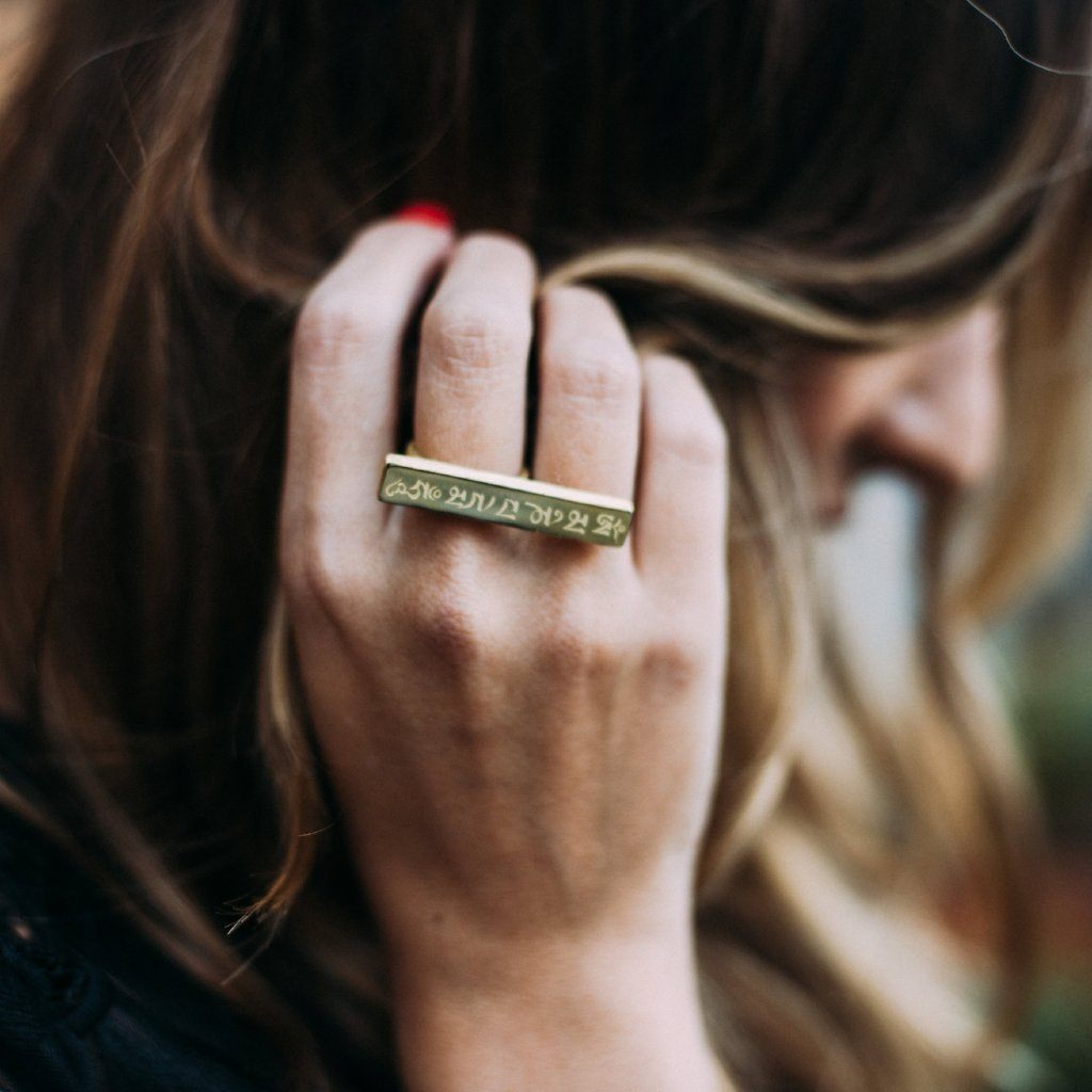 Olia of Love Olia brushing back her hair wearing Mantra Long Knuckle Ring With Edge