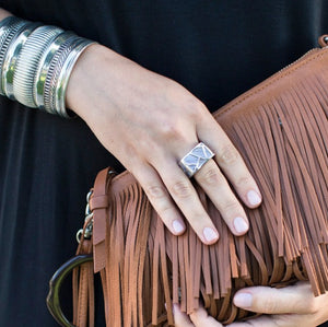 woman with multi bracelets holding fringe bag wearing Square Cocktail Ring