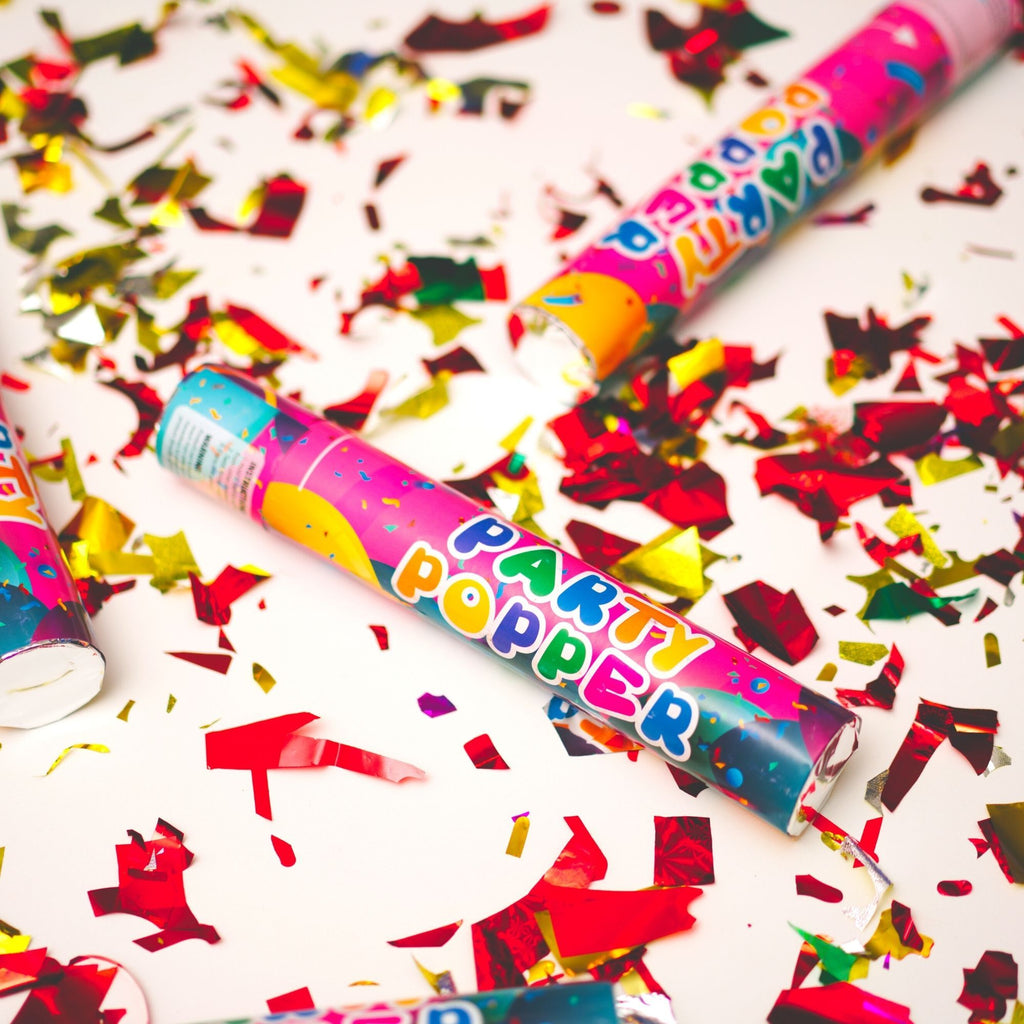 confetti cannon surrounded by red and gold confetti
