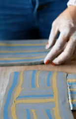 Nerikomi pottery method: making a pattern from different striped clay slabs