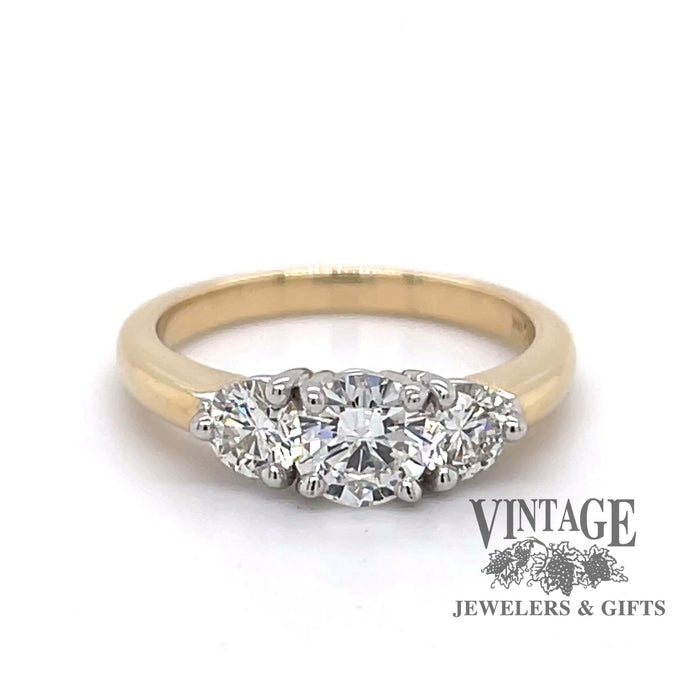 Revolving 360 degree video of 1.34 ctw.14k gold three stone diamond ring .